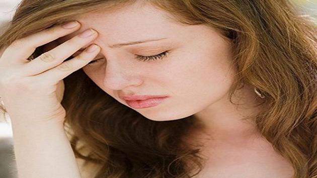 Nhức đầu là một trong những triệu chứng phổ biến của cao huyết áp